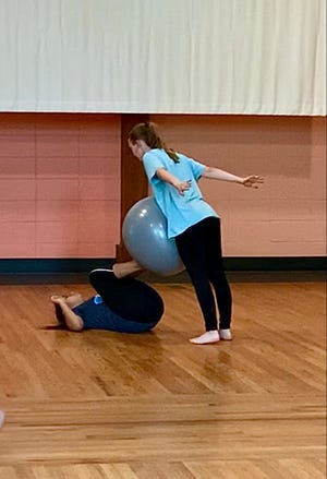 Adela Almazan-Osmundson and Laura Newman practice choreography during a Kids Co'Motion workshop.