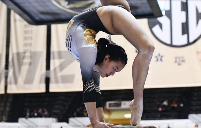 Missouri gymnast Helen Hu performs her beam routine during a 2020 meet at the Hearnes Center.