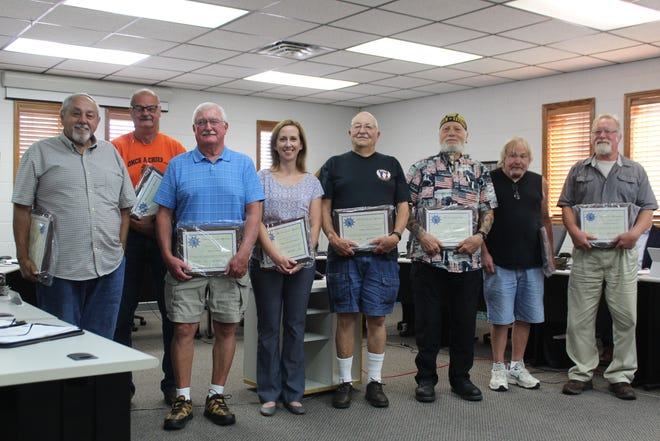 """(From left) Tom Smith, Mike Donovan, Pat Bolen, Sara Cunningham, Phil Oppenheiser, Richard """"Duke"""" Mayo, Duane Swan and Mike Remus of the Cheboygan County Veterans Memorial Park Committee were honored at the Cheboygan County Board of Commissioners meeting Tuesday for all their hard work improving the park."""