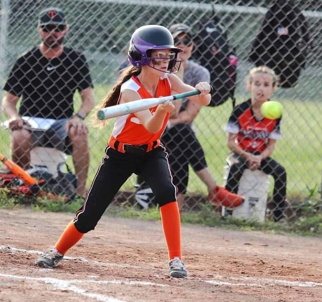 Cheboygan's Emma Maxwell looks to lay down a bunt during a recent Michigan Little League Minor Girls (8-10) softball state tournament game in Rochester Hills.