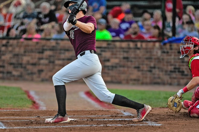 Outfielder Josh Swinehart (Kalamazoo, Mich./Western Michigan U.) of the Chillicothe (Mo.) Mudcats and St. Joseph Mustangs catcher Jaxon Himell have their gaze fixed on the first-inning pitch Swinehart has hit high and deep to left field at Phil Welch Stadium in St. Joseph during the teams' Monday, July 26, 2021, MINK League North Division playoff game. The park couldn't hold the blast, Swinehart's fourth home run of the season, which gave the Mudcats a 1-0 lead. With Swinehart later singling home his 36th RBI of the season, Chillicothe eventually carried a 3-1 lead into the bottom of the seventh inning before St. Joe rallied with two runs in the seventh and two in the eighth to win, 5-3, and end the Mudcats' season.