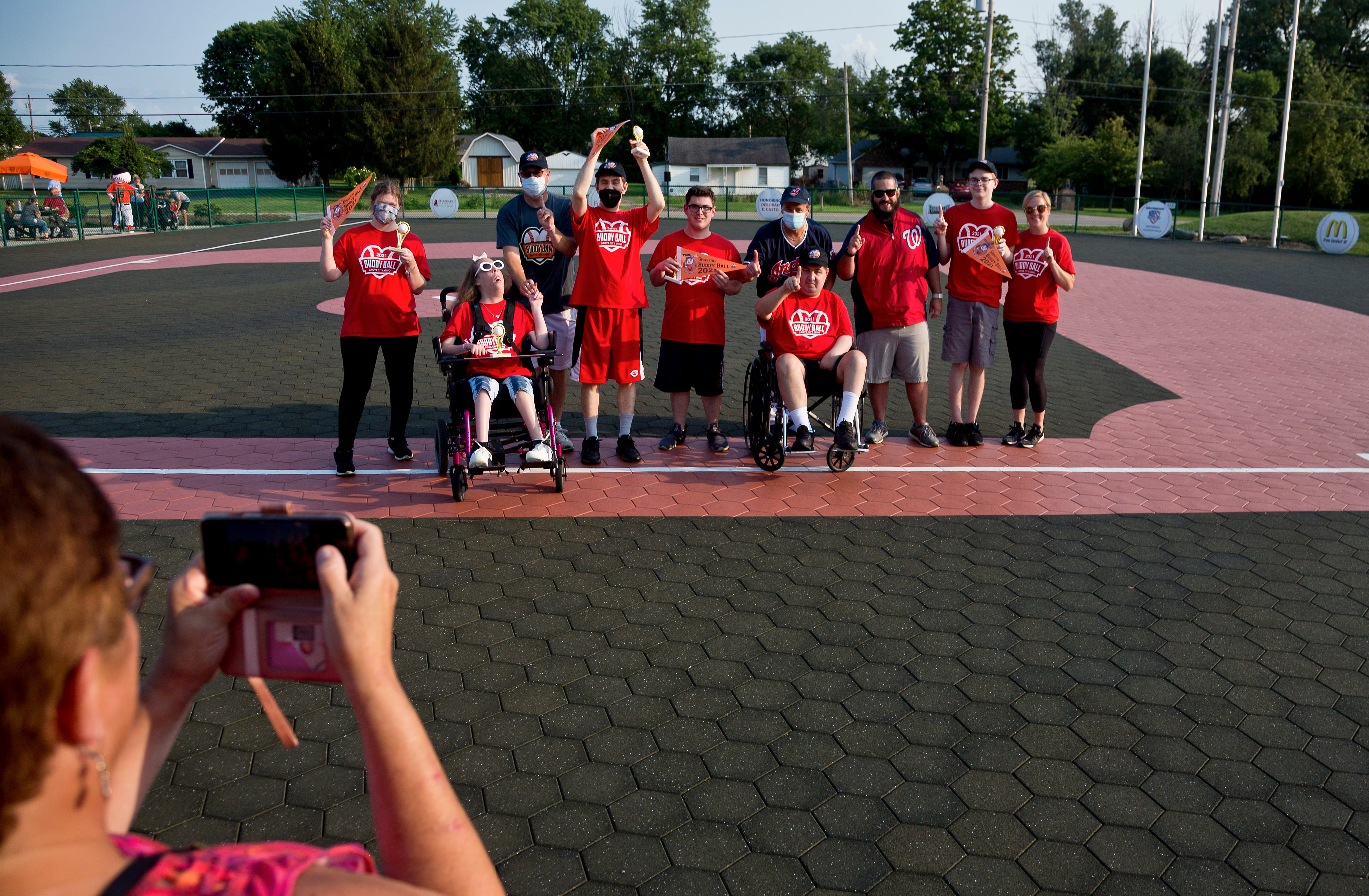 Everyday Hero Mark Sigrist photographed with his buddy Derek Somers and other teammates during the final Buddy Ball game of the summer session on Wednesday, July 14, 2021.