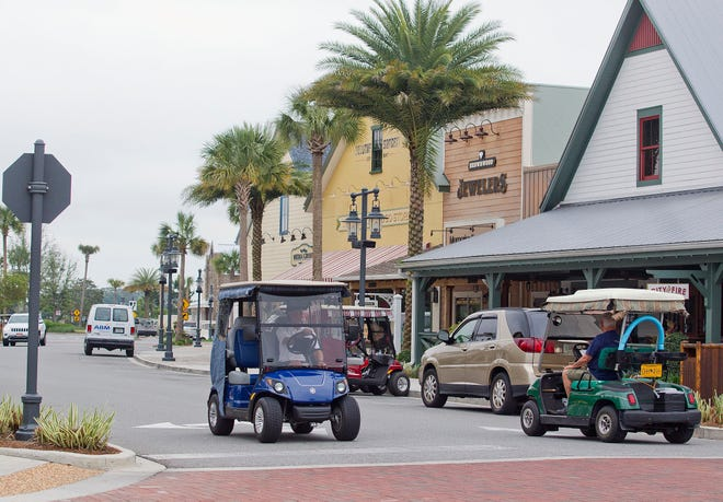 Villagers in their golf carts, make their way around Brownwood Paddock Square. Lake County Commissioners Tuesday approved an economic development grant to help The Villages build a $100 million mixed-use complex that will include a regional hospital at Florida's Turnpike and County Road 470.