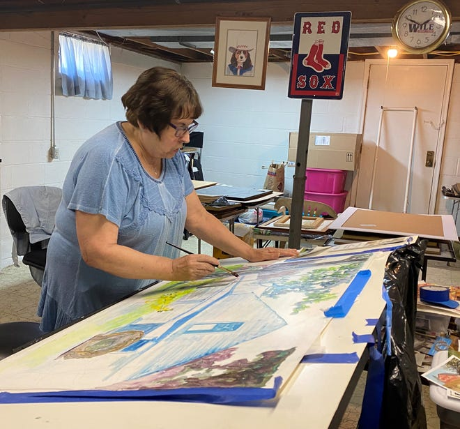 Local artist Martha Davis Rice works on a watercolor painting in the basement studio at her Cambridge home. She was been exhibiting artwork at the Salt Fork Arts & Crafts Festival for more than 30 years.