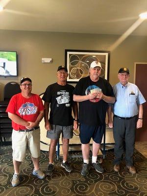Jack Volk and legionnaires Gary Ertmann and Conrad Schell presented $3500.00 to first place winner Wade Schlecht. of Streeter ND.