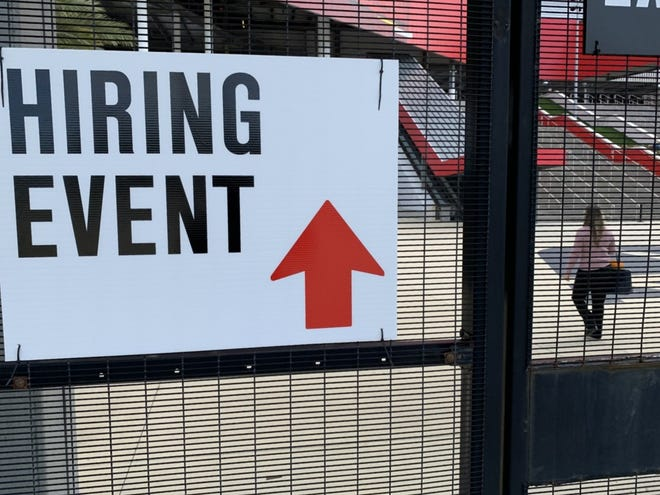 A job seeker can be seen entering Daytona International Speedway for a hiring event in December 2020. The Speedway will be holding five more hiring events in late July and early August to fill seasonal positions for this year's Coke Zero Sugar 400 weekend in late August. The first of the hiring events will be on Thursday, July 29, from 10 a.m. to 5 p.m.