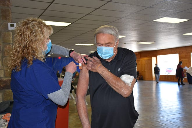 Sarah Mickel, LPN, administers a COVID-19 vaccine to Thomas Bajadek at the former Rusty Palmer's in Honesdale in March.