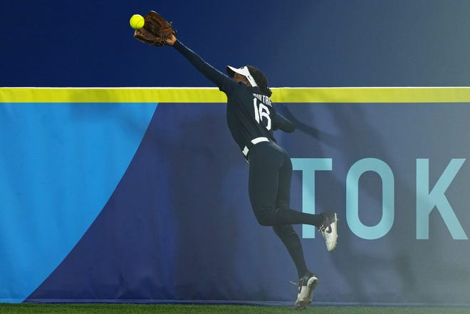 United States right fielder Michelle Moultrie (16) makes a catch against Japan for the final out of the second inning in the gold medal game.