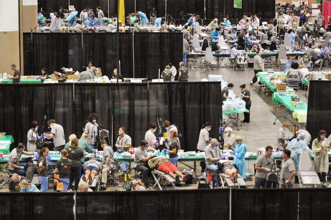 Hundreds of patients are seen during a 2016 Florida Mission of Mercy free dental clinic in the Prime Osborn Convention Center in Jacksonville. The clinic being held there this year will look different because of COVID-19 safety measures.