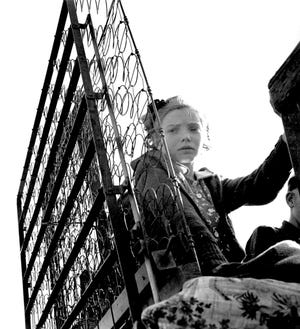 """""""Girl with Mattress Springs""""  in California, by Dorothea Lange, 1935,US Farm Security Administration."""