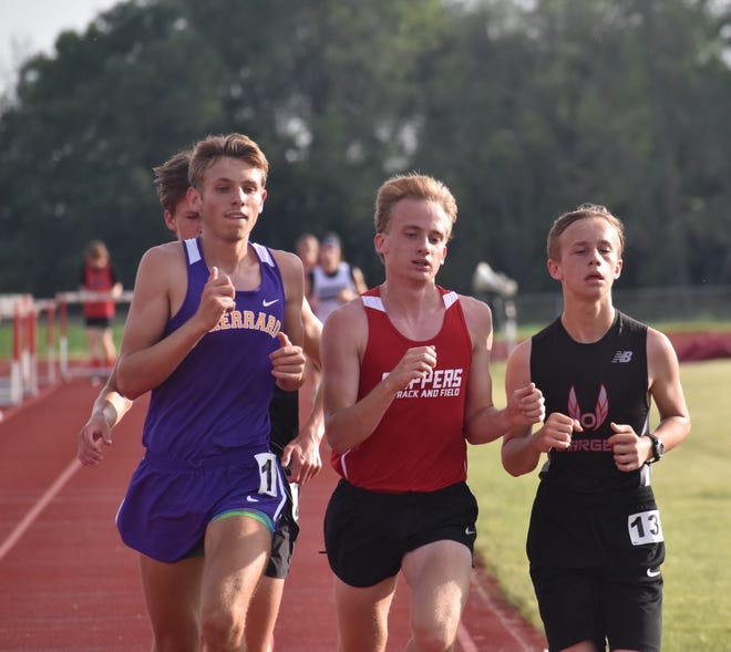 Orion's Tate Schneider, right, runs shoulder-to-shoulder with boys from Sherrard and Amboy in the 3200-meter run on Friday, June 11, at the IHSA's Class 1A sectional at Erie Middle School.