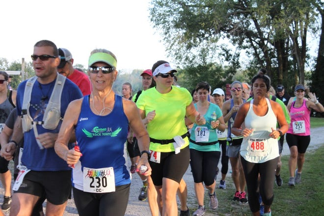 Judie Gulley starts the 2019 Charger 10-Mile at the Rock Island Conservation Club on Big Island Road in Milan. This year's Charger 10-Mile and the Tommy and Lindsey Nicholson 5K will be on Saturday, Sept. 4. The 10-mile race starts at 7:30 a.m. and the 5K at 7:45 a.m.