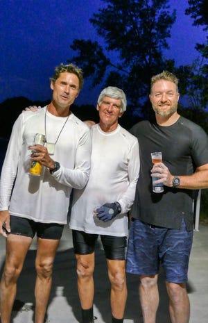 Rob Hartman (left), Billy Bellinger (center) and Wayne Arthur (right) kayaked 80 miles across Lake Michigan on Sunday
