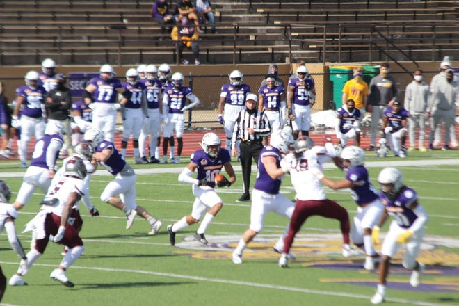 Western Illinois receiver Dennis Houston looks for running room during a game last spring.