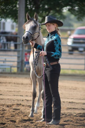 4-H'ers show their horses at the Chippewa County Fair Tuesday morning.