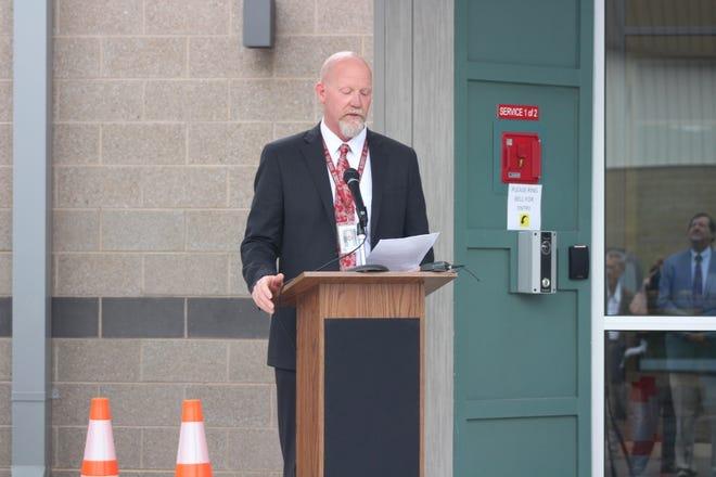Oak Ridge School's Superintendent Bruce Borchers speaks at the Oak Ridge Preschool's ribbon cutting ceremony.