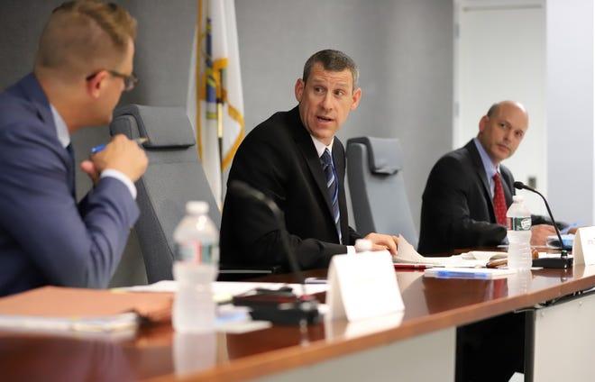 Jamey Tesler, of Hingham, center, has been named state transportation secretary.