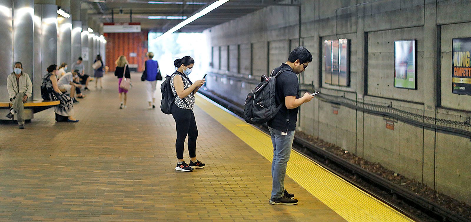 Inbound commuters wait for a train in Quincy Center on Tuesday, July 27, 2021. The South Shore extension of the Red Line turns 50 this year.