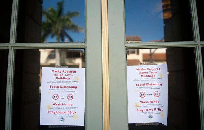 The Town of Palm Beach announced Monday that it would require facial coverings and social distancing while indoors on town property. This noticed was posted at Town Hall.