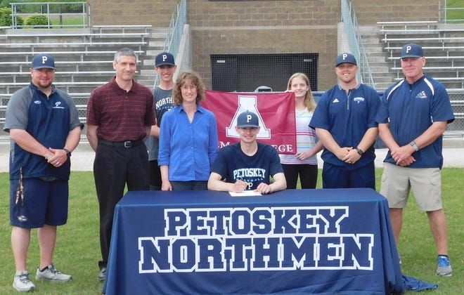 Recent Petoskey graduate Ty Slater will move on to the collegiate level and play baseball at Alma College. Joining Slater at his commitment were (from left)  Petoskey head coach, Shawn Racignol; father, Troy Slater; brother, Grant Slater; mother, Christi Slater; sister, Rachel Slater; JV Blue coach, Dennis Kan; and assistant coach, Mike Loper.