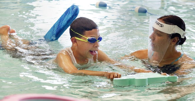 In a program run by Providence Community Health Centers in concert with Pods Swimming in East Providence, Kelvin Tejada, 9, of Providence, gets a lesson from instructor Jenna Greenwood on Tuesday.