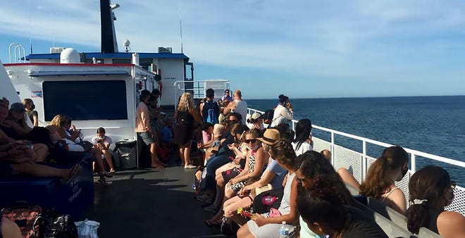 Passengers take in the sun on the top deck of the Block Island Ferry in this image from video taken in June 2020. The ferry operator struggled to enforce a mask requirement on the boats last summer.