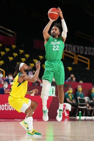 Jul 25, 2021; Saitama, Japan; Nigeria player Nnamdi Vincent (22) shoots during a game against Australia during the Tokyo 2020 Olympic Summer Games at Saitama Super Arena. Mandatory Credit: Kyle Terada-USA TODAY Sports