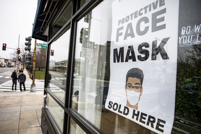 A sign advertising protective face masks is taped in the window of a coronavirus pop-up store in Washington, D.C., on March 6, 2020. Photo by Samuel Corum/Getty Images