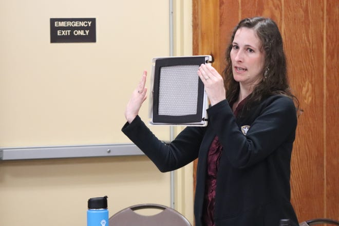 Terri Dzienis, the head of Canton City Public Health's air pollution control division, shows an air quality monitor filter at a July 20 public meeting about Republic Steel. She said Monday that the health department is planning to offer community lead testing.