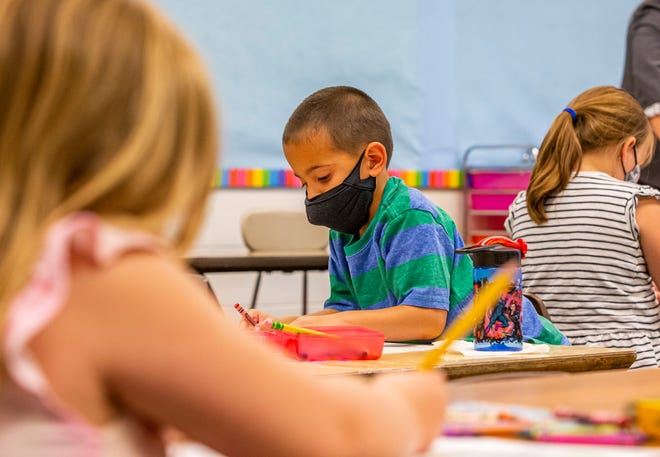 Paetyn Rasing, 5, wears a mask Tuesday during an early kindergarten program at Swanson Traditional School in South Bend.