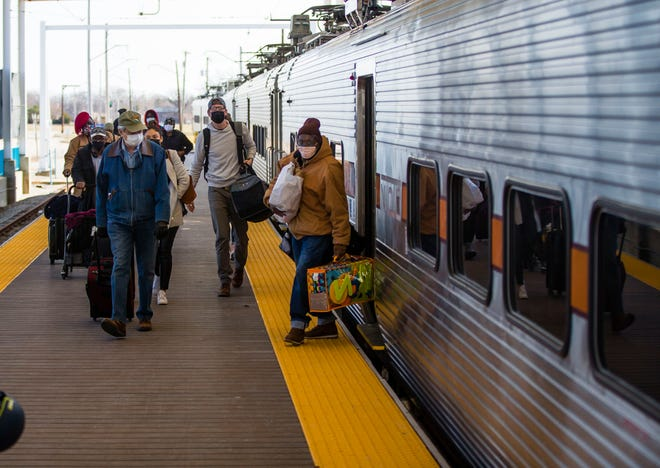 Passengers exit a South Shore train in March at South Bend International Airport.