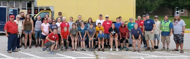 Volunteers at the Serving Owen County... Together event posed for a photo on the day of the event.