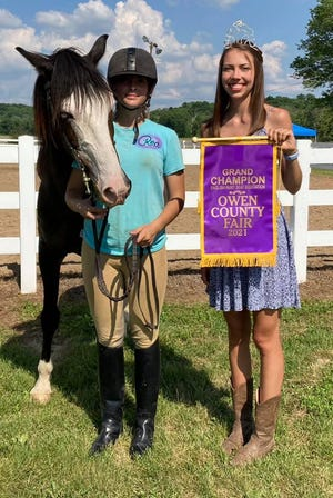 Rea Hinshaw was the winner of the Grand Champion banner for English Equitation at the 2021 Owen County Fair. She is shown with her horse Geo and 2019/2020 OC Fair Queen Kara Schafer.