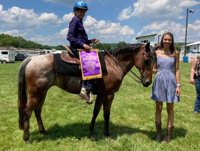 Kenzi Bixler was the Grand Champion for Western Horsemanship at the 2021 Owen County Fair. She is shown atop her horse Rosie and alongside 2019/2020 OC Fair Queen Kara Schafer.