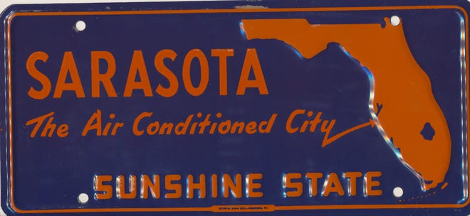 """A front license plate advertising the """"air-conditioned city,"""" ca 1958."""