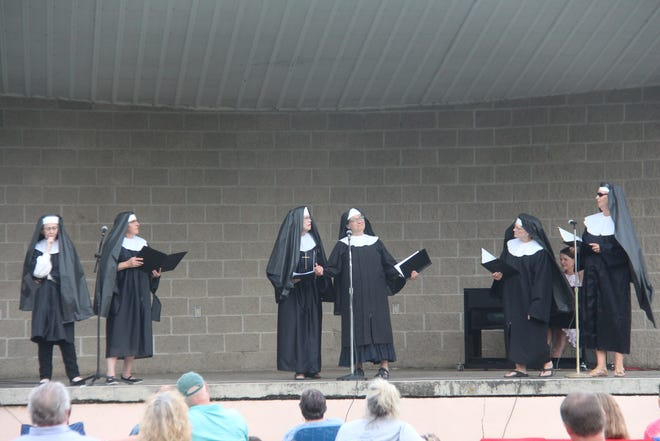 """One of the groups preforming 'Maria' from """"The Sound of Music"""" during Broadway in the park"""