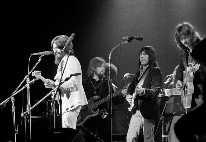 George Harrison, left, formerly of the Beatles, performs at a benefit concert for East Pakistani refugees at Madison Square Garden in New York on Aug. 1, 1971. Backing him up are, left to right: Klaus Voorman (bass), Jesse Ed Davis (guitar), and Eric Clapton (guitar).