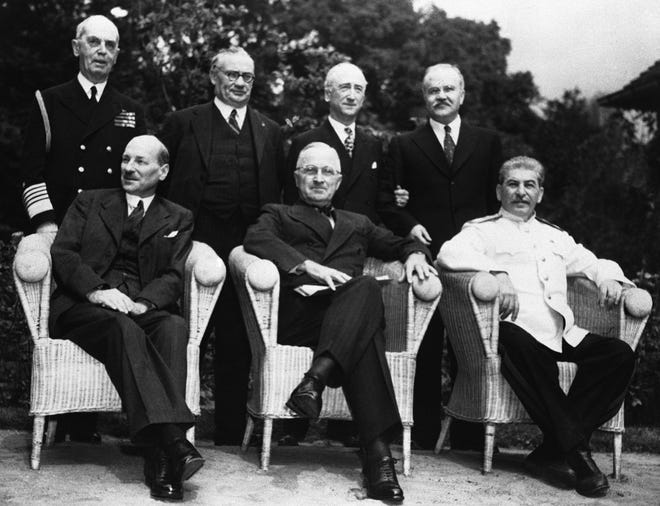 On Aug. 2, 1945, the Potsdam meeting of the big three came to an end with an agreement that Germany was to be totally disarmed and a close control kept on her heavy industries. Seated left to right: Britain's Prime Minister Clement Attlee, American President Harry S. Truman and Russian President Marshal Joseph Stalin. Standing left to right are: Adm. William Leahy, Ernest Bevin,  James  Byrnes and Vyacheslav Molotov as they met for their final talk at Potsdam on August 3, 1945.