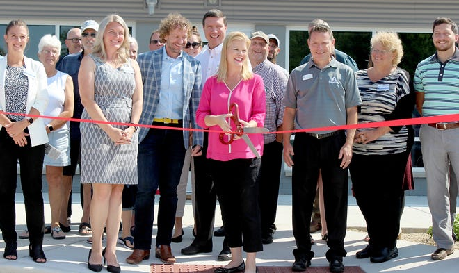 Kristen McEnroe, Jamie Clark, Christy Trammell and Rex Scare were among participants involved in a ceremonial ribbon-cutting commemorating the opening of Three Rivers Chamber of Commerce at its new location.