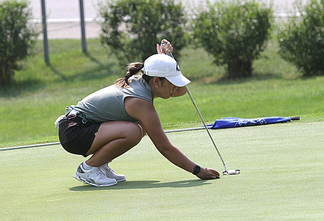 Jasmine Ly, who finished just a single shot outside of first place, lines up a putt on hole No. 9 Tuesday at Klinger Lake CC.