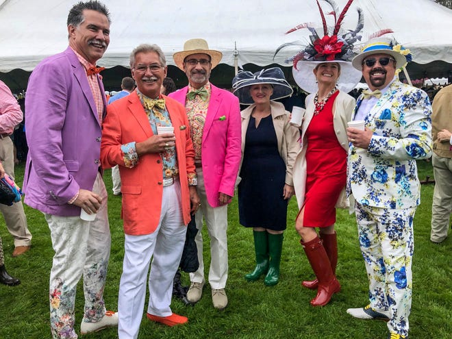 From left, Gary Kirkegaard, Curt Hursey, Kevin Karas, Samantha Wood, Phyllis Goodson and Tony Britt Kirkegaard at the Azalea Festival garden party at Arlie Gardens in 2019. This year's pandemic-delayed party is being held in July for the first time.
