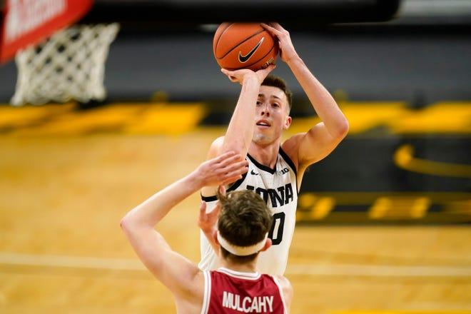 Iowa guard Joe Wieskamp shoots over Rutgers guard Paul Mulcahy last season in Iowa City, Iowa.