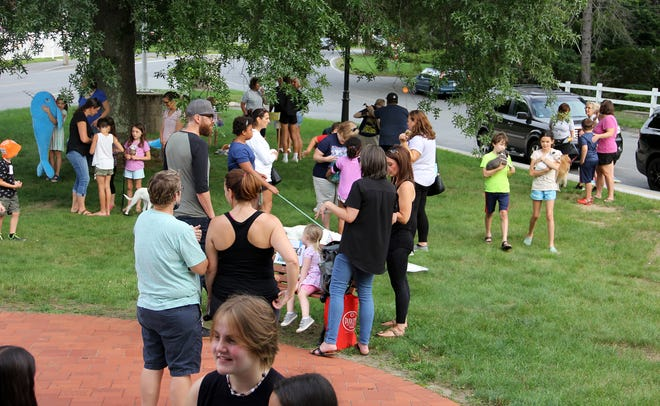 Participants mill around the front lawn of West Boylston's Beaman Library prior to the annual pet show.