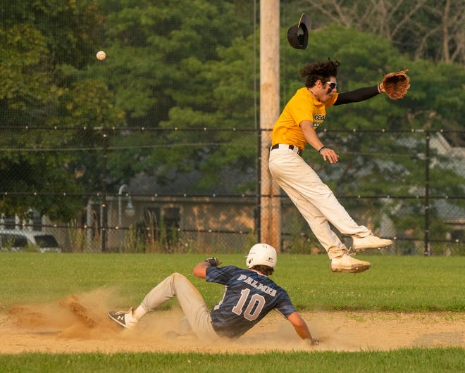 Holden's Owen Palmer has a stolen base as the ball sails over the head of the Knights' Jack McGrath during a PNJ Senior Babe Ruth game Monday at Vernon Hill Park.