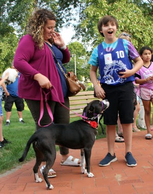 Ean Giobellina and his rescue dog, Sawyer, reacts to hearing he won Best of Show in the July 22 Beaman Library Pet Show, in West Boylston. The show attracted 85 people and the entry fee was donated to the Worcester Animal Rescue League.