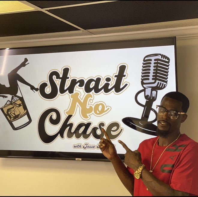 """Jesse Mitchell, 35, preparing to record an episode of his podcast, """"Strait No Chase."""""""