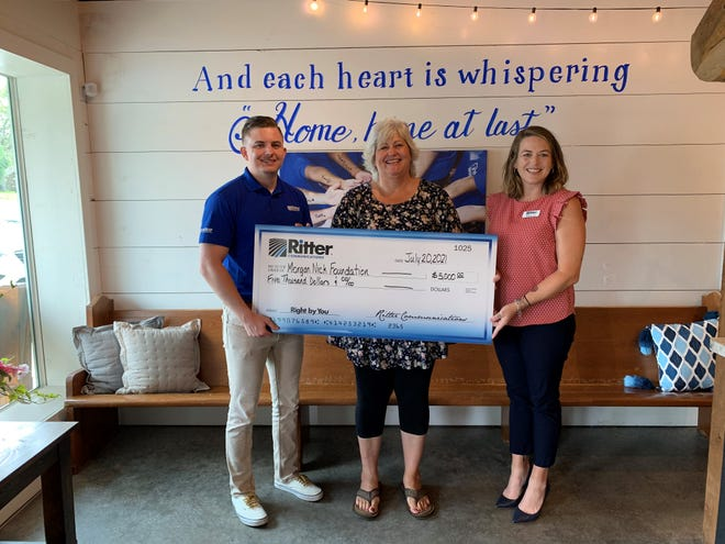 Colleen Nick of the Morgan Nick Foundation accepts a $5,000 donation from Ritter Communications Enterprise Account Manager Oni Robertson and Ritter Communications Marketing Coordinator Melissa Cole.