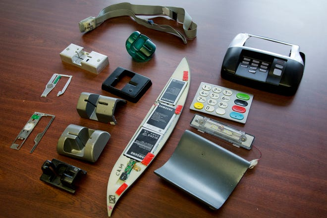 In this April 18, 2018 photo, a variety of tools used to skim information from credit cards are displayed at the office of the New York Police Department's Financial Crimes Task Force. The U.S. Secret Service says more than a billion dollars is stolen from U.S. consumers each year by credit card skimmers, money that funds organized crime and which is usually passed back to consumers through higher fees.