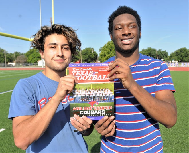 Cooper's Jett Villarreal, left, and Jacobe Moore pose with a copy of Dave Campbell's Texas Football special edition commemorating the Abilene Cooper Cougars. Texas Football gave the Coogs free copies of the magazine Tuesday, July 27, 2021 at Cooper High School.