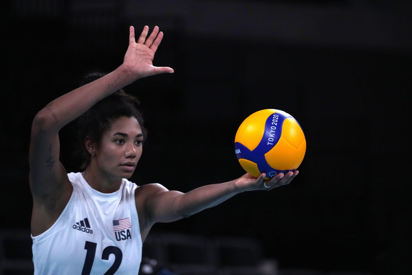 USA opposite hitter Jordan Thompson (12) prepares to serve the ball in a women's Pool B match against China during the Tokyo 2020 Olympic Summer Games at Ariake Arena on July 27. The United States defeated China, 29-27, 25-22, 25-21.